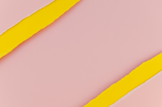 Pink and yellow torn paper