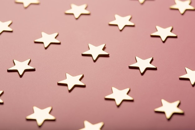 Pinky background with golden stars