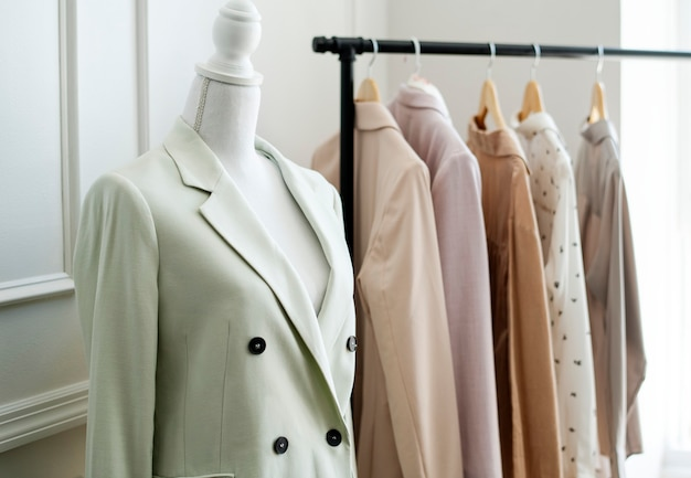 Pinnable mannequin by a clothing rack