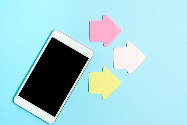 Pinned variety of empty color paper sticker notes mock up used for content. paper notebook accessories and school supplies with mobile phone arranged on different flat lay backgrounds