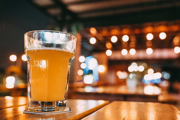 Pint of beer on restaurant table with copy space