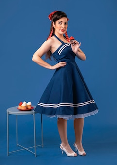 Pinup girl posing next to a table