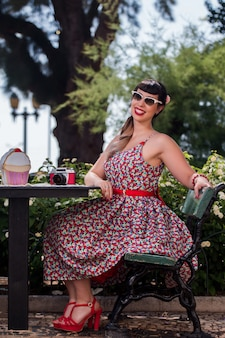Pinup girl relaxing in the park