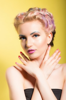 Pinup style portrait of a young beautiful woman with blue eyes and makeup