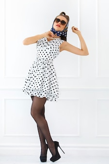 Pinup woman in cute dress