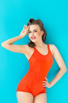 Pinup woman in red swimsuit