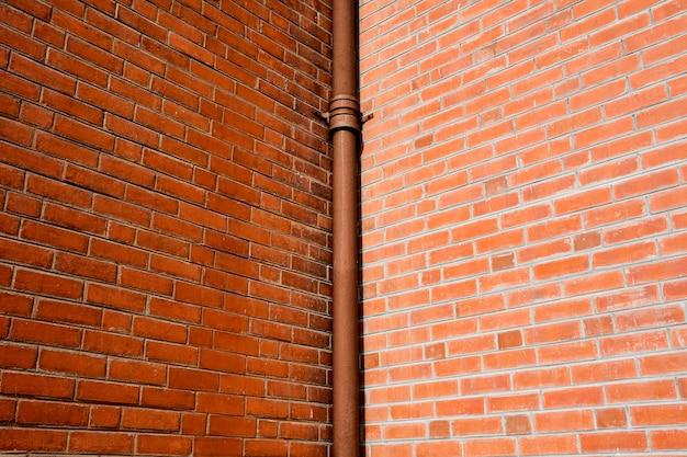 Pipe at antique brick building