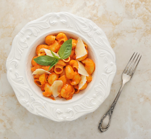 Pipe rigate pasta with cheese, basil