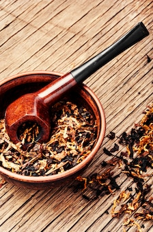 Pipe and tobacco on rustic table