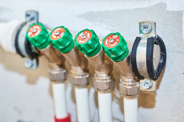 Pipes and valves for hot and cold water in a heating and water supply system