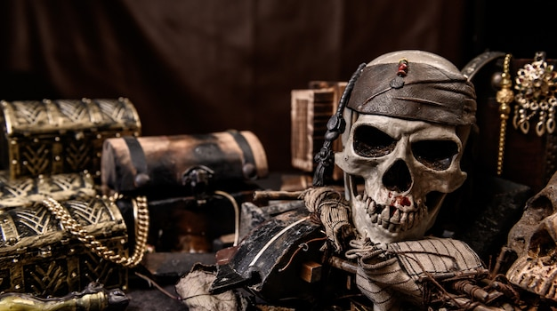 Pirate with human skull. treasure chest and gold. discovery equipment and explorer for disappear fortune.