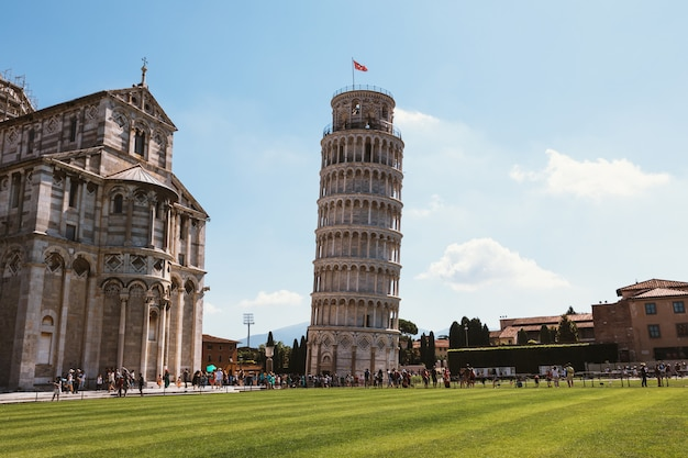 Pisa, italy - june 29, 2018: panoramic view of leaning tower of pisa or tower of pisa (torre di pisa) is campanile on piazza del miracoli, or freestanding bell tower, of cathedral of pisa city