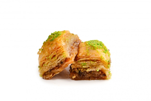 Pistachio baklava on a white background. dessert.
