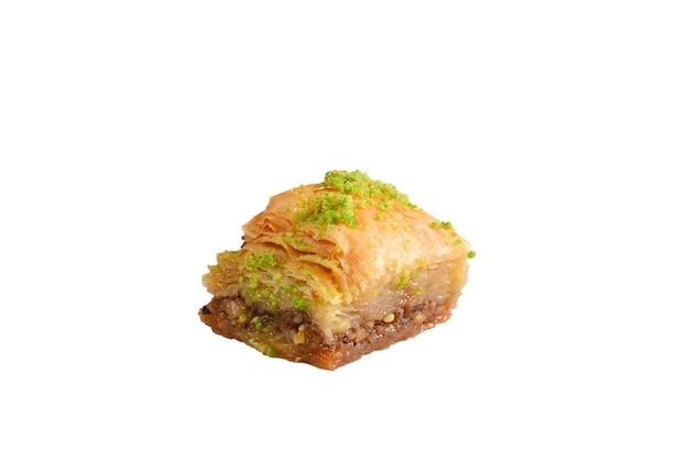 Pistachio baklava on a white surface