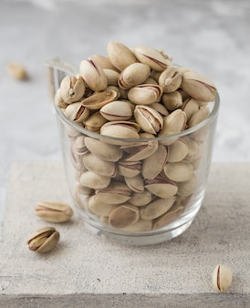 Pistachio nuts on concrete background. roasted salted pistachios.