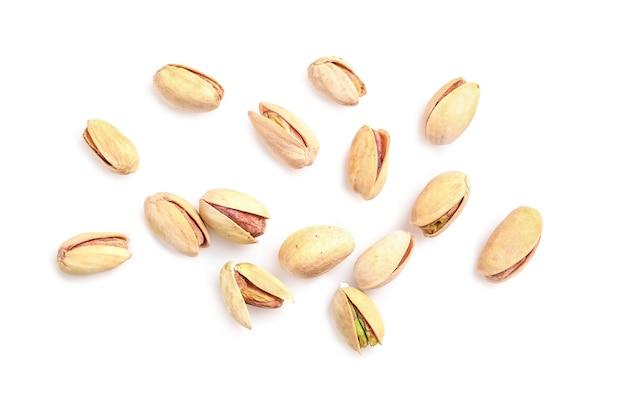 白で分離されたピスタチオナッツ