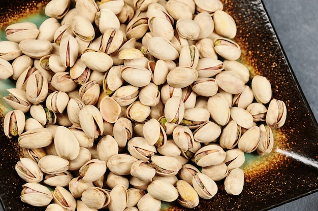 Pistachios in a bowl - top view