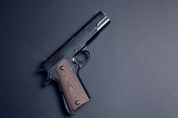 Pistol on a black background