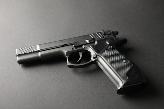 Pistol on black. self defense weapon