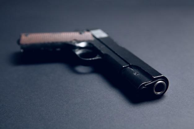 Pistol on a black surface