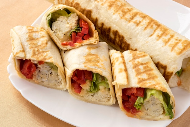 In pita bread omelette lettuce and sliced peppers.