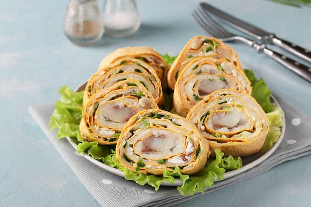 Pita roll with herring, potatoes and onions