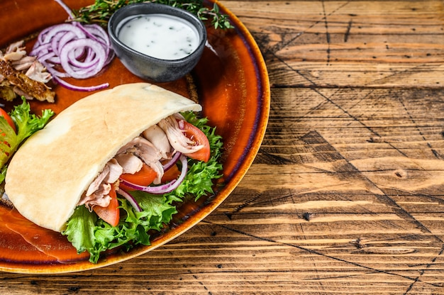 Pita salad with roasted chicken and vegetables on a plate