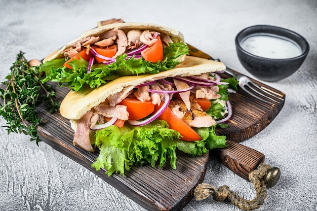 Pita sandwich with roasted chicken, vegetables and delicious sauce