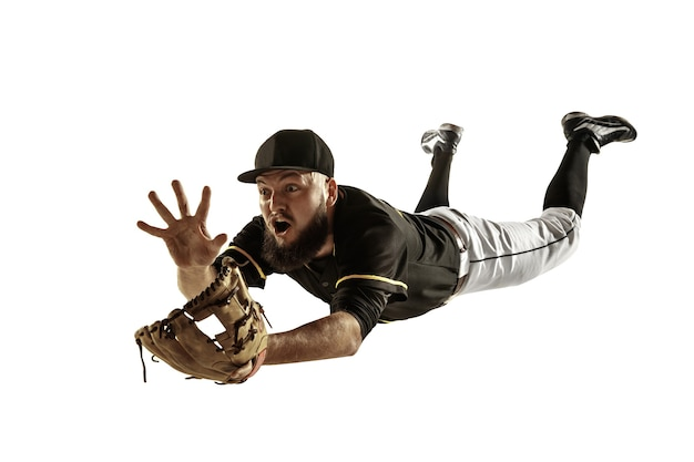 Pitcher in a black uniform practicing on a white wall