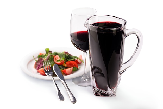 Pitcher with red wine and salad