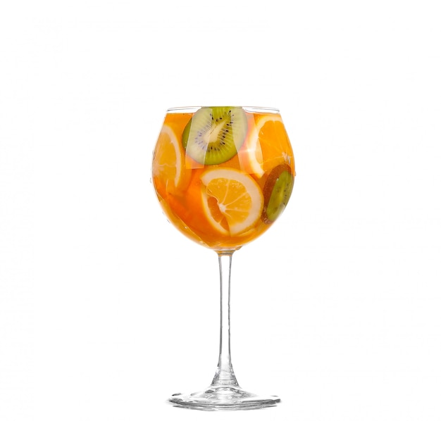 Pitcher with a refreshing drink with lemon slices of orange and kiwi on white