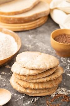 Pitta breads close up. freshly baked wholegrain flat bread.