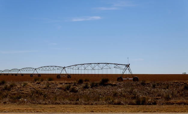 Pivot irrigation system at farmland in the arizona desert.