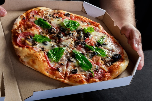 Pizza box delivery with hot tasty italian sliced pizza
