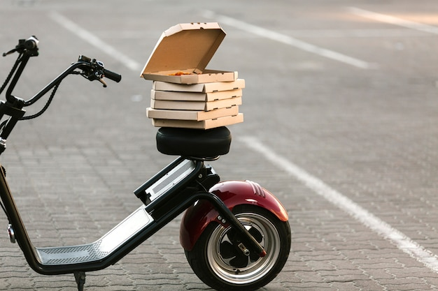 Pizza boxes on delivery motorcycle