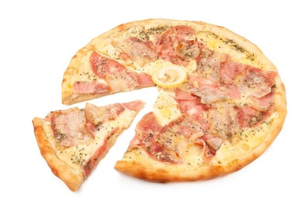 Pizza carbonara. with parmesan, mozzarella, bacon, ham, oregano and lemon. a piece is cut off from pizza. white background. isolated. close-up.