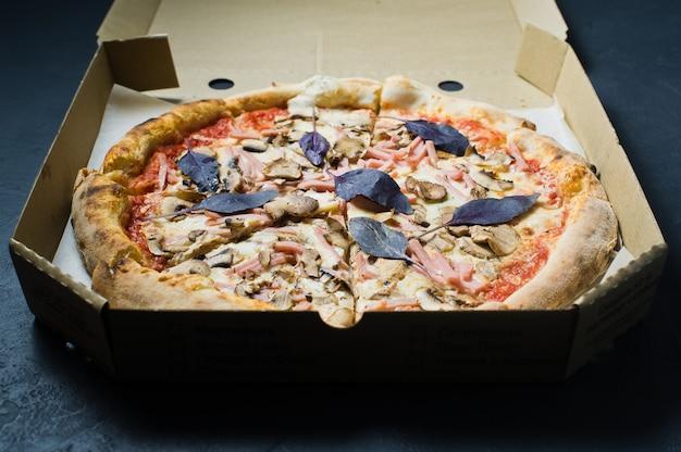 Pizza in a cardboard box. pizza delivery. pizza menu.
