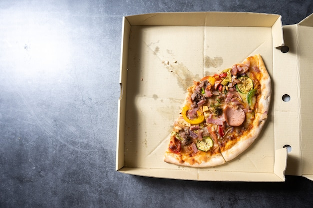 Pizza in cardboard pizza box. top view
