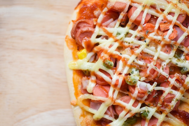 Pizza cheese sauce pizza topping sausages hot dog ketchup and spices food and tasty