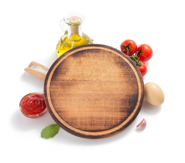 Pizza cutting board with  ingredient isolated on white