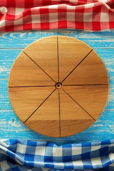 Pizza cutting board at wooden