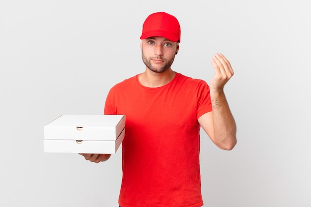 Pizza deliver man making capice or money gesture, telling you to pay
