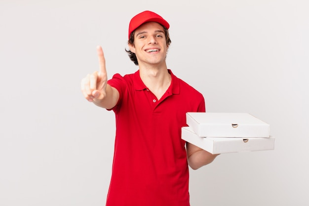Pizza deliver man smiling proudly and confidently making number one