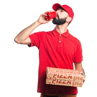Pizza delivery man drinking a soda