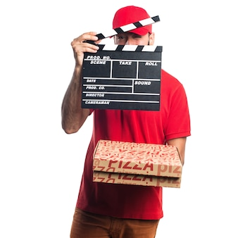Pizza delivery man holding a clapperboard