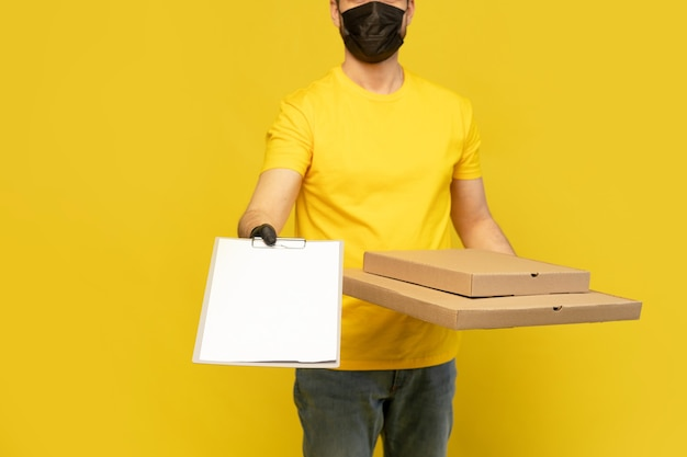 Pizza delivery man in mask looking at camera isolated. coronavirus 2019ncov concept