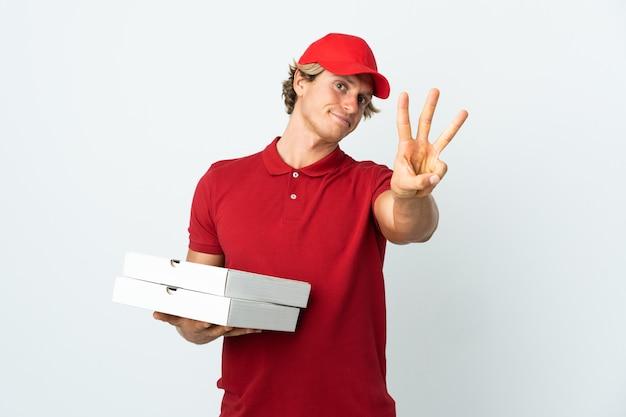 幸せで、指で3つを数えて孤立した白い壁の上のピザ配達人