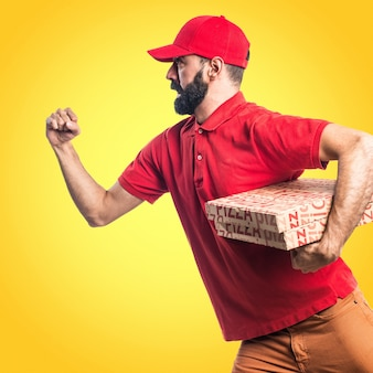 Pizza delivery man running fast on colorful background