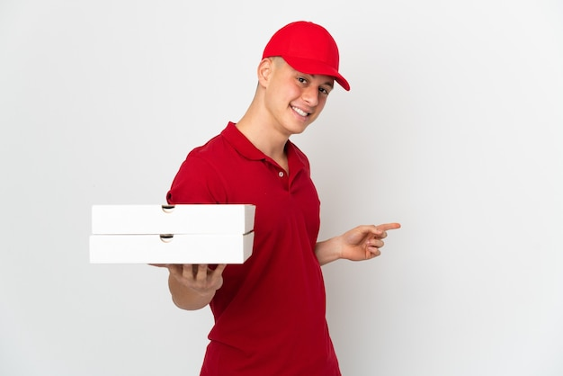 Pizza delivery man with work uniform picking up pizza boxes isolated