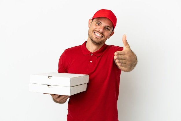 Pizza delivery man with work uniform picking up pizza boxes